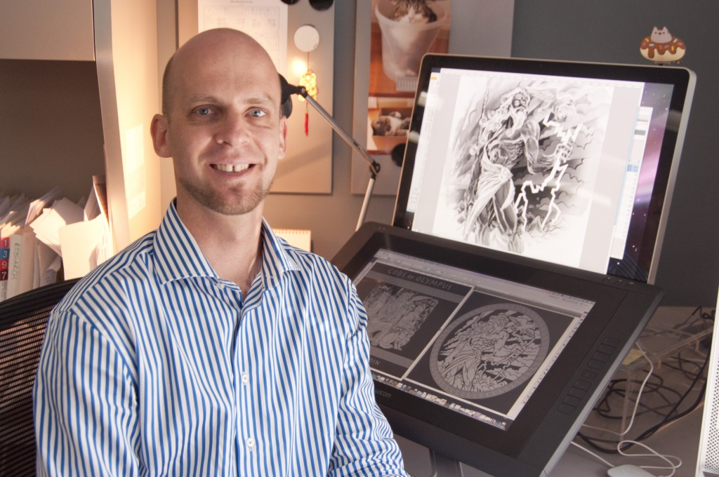 Perth Mint designer Ton Vaughan at his computer, with the Zeus concept art