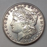 The strike on this counterfeit Morgan Dollar is off-center, losing the rim on the lower left
