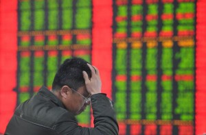 Interestingly, stock tickers in China use green numbers to indicate losses.