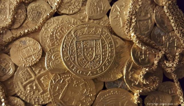 Handout photo of gold coins and gold chain found in the wreckage of a 1715 Spanish fleet that sunk in the Atlantic
