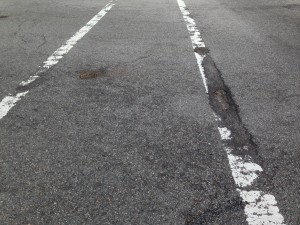 Road_surface_deterioration_by_pavement_markings