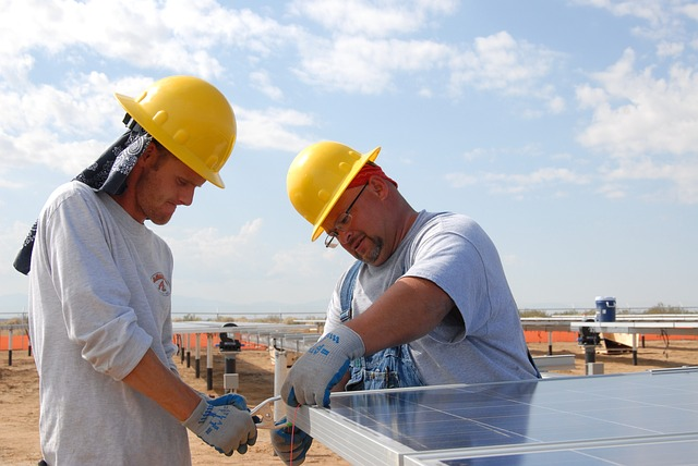 solar-farm-workers-panels-installation