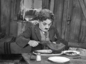 "Charlie Chaplin's ""Little Tramp"" is forced to eat his own shoe to survive the Klondike winter in 1925's ""The Gold Rush"""